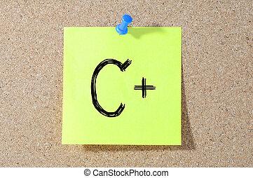 C+ grade written on a test paper.