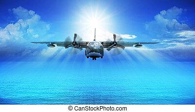 c123 military plane landing with blue sky sun shine...