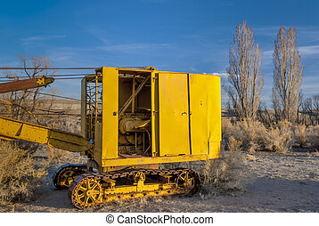 Cab of an old yellow tractor