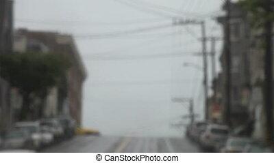 cab on San Francisco hill - a cab crosses a hilltop...