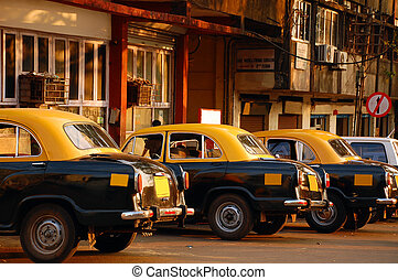 Cab Stand in India - Yellow & black cars at the cab-stand in...