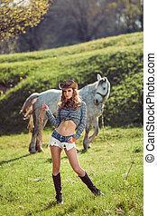caballo, y, niña, con, sombrero vaquero