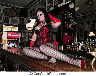 Cabaret woman lying on a bar