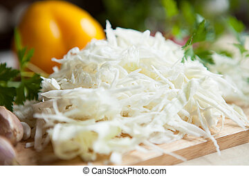 Cabbage cut into chunks on a wooden surface