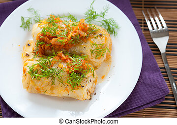 cabbage roll on white plate, top view