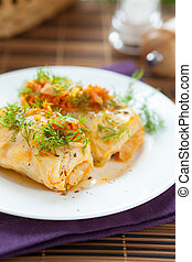 cabbage roll stuffed with rice on white plate