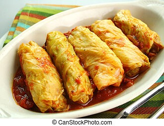 Cabbage Rolls - Piping hot baked cabbage rolls with a tomato...