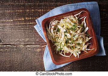 Cabbage salad on the wooden table top view