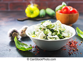 cabbage salad in bowl and on a table