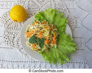 Cabbage salad with lemon, on plate