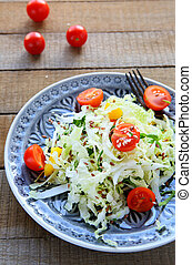 cabbage salad with tomatoes and vegetables