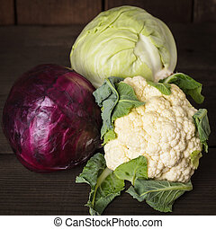 Cabbage types on the wooden table close up