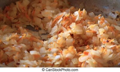 Cabbage with vegetables and chopped carrots is fried in frying pan