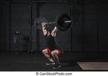 cabeza, ataque, cuclillas, atleta, joven, cruz, barra con pesas, encima