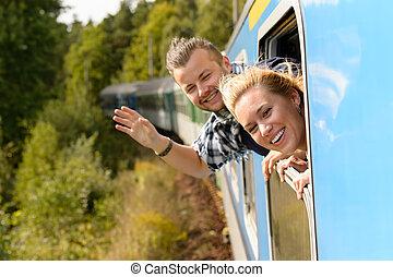 cabezas, el par saludar con la mano, ventana, tren, afuera