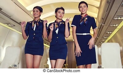 Cabin crew dancing with joy in airplane . Airline transportation and tourism concept.