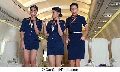 Cabin crew dancing with joy in airplane