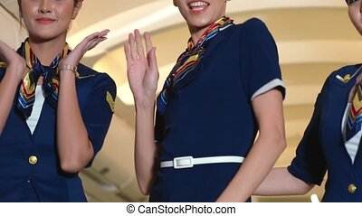 Cabin crew dancing with joy in airplane . Airline ...
