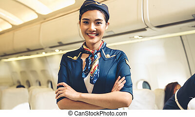 Cabin crew or air hostess working in airplane