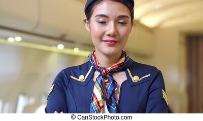 Cabin crew or air hostess working in airplane . Airline ...