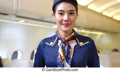 Cabin crew or air hostess working in airplane . Airline transportation and tourism concept.
