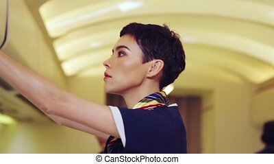 Cabin crew provide service to passenger in airplane . Airline transportation and tourism concept.