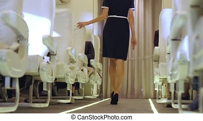 Cabin crew walking in airplane during a night flight . ...