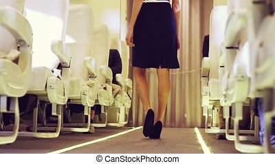Cabin crew walking in airplane during a night flight . Airline transportation and tourism concept.