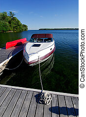 Cabin Cruiser Boat Tied Up At The Cottage Dock On Lake Simcoe, Canada