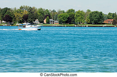 cabin cruiser on a river