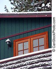Cabin in snow woods