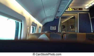 Cabin of coach in a train. Passengers traveling by railroad