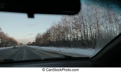 cabin of the car while riding in winter. slow motion video