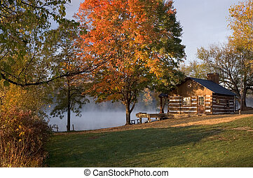 Cabin on the Lake - A log cabin on the edge of a lake with...