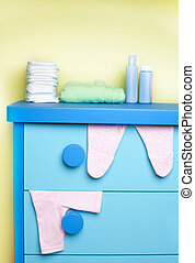 cabinet in nursery room ready for newborn baby