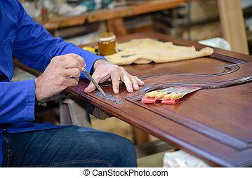 cabinet maker at work