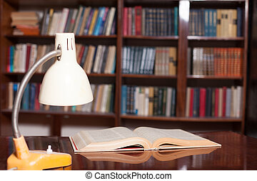 Cabinet with books table lamp