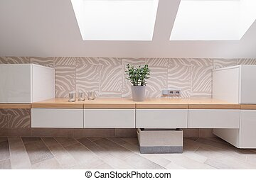 Cabinets in modern dressing room - Horizontal view of white...