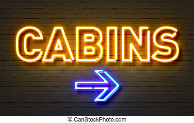 Cabins neon sign on brick wall background.