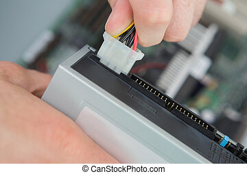 Close-up of cable being plugged