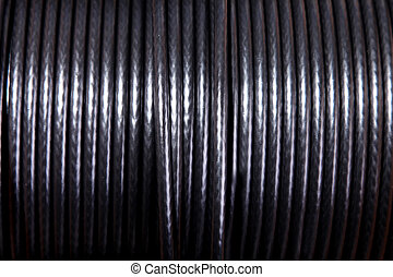 Black power cable on roll. Background image