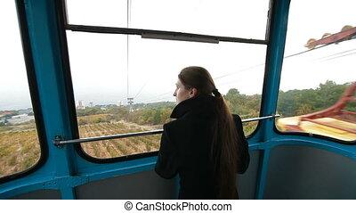 cable-car Ai-Petri - woman looks through the window cabin...