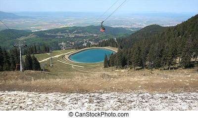 Cable car and lake viewed from Postavaru peak, Brasov,...