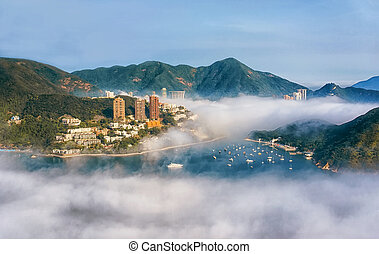 Cable car in Hong Kong, view over the clouds of the mountains, Bay and city on a Sunny day, horizontal frame