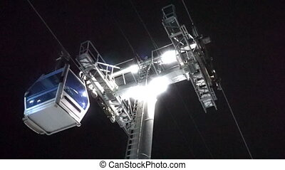 Cable car lift at ski resort. Night skiing from the...