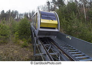 Cable car on the side of a mountain.