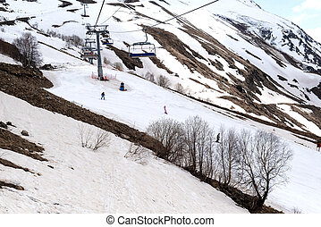 cable car with a ski run in the Caucasus mountains in the spring