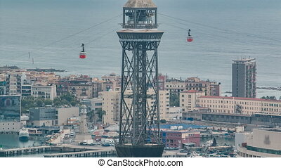 cable cars crossing at a pylon in barcelona harbour timelapse