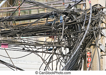 cable mess - bunch of electrics and communication wires in...
