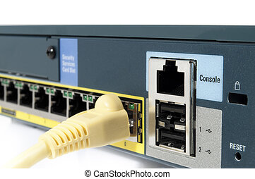Yellow cable plugged in an ehternet firewall